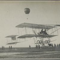 [Farman 1910 Biplane taking off]