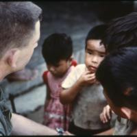 [Man with Vietnamese children]