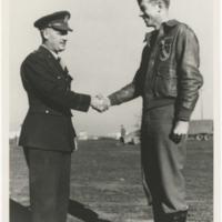 [Robert L. Baseler receiving Silver Star from General Nathan Twining]