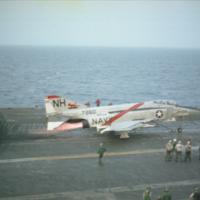 [McDonnell F-4 (F4H) Phantom II preparing to take off from USS Kitty Hawk]