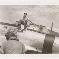 [William D. Dunham standing in cockpit of Republic P-47D (F-47D) Thunderbolt]