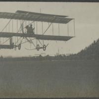 [Farman 1910 Biplane in flight]