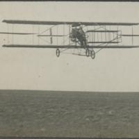 [Curtiss aircraft in flight]