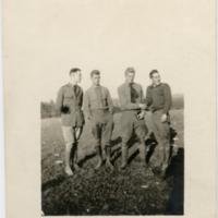"[Norman ""Jim"" Archibald with three unidentified servicemen]"
