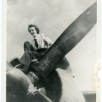 [Martha L. Bullock sitting on airplane]