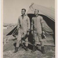 [Two men wearing F-1 flight suits]