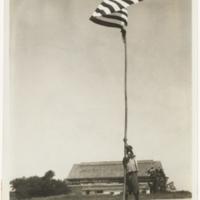 [Indian prisoner of war raising American flag at airstrip in Hanoi, Vietnam]